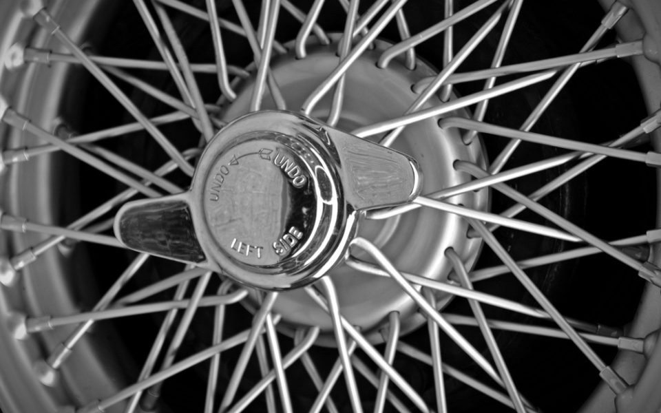 An image of an old car wheel with spokes