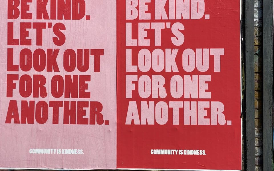 "A poster with the words ""Be kind. Let's look out for one another""."