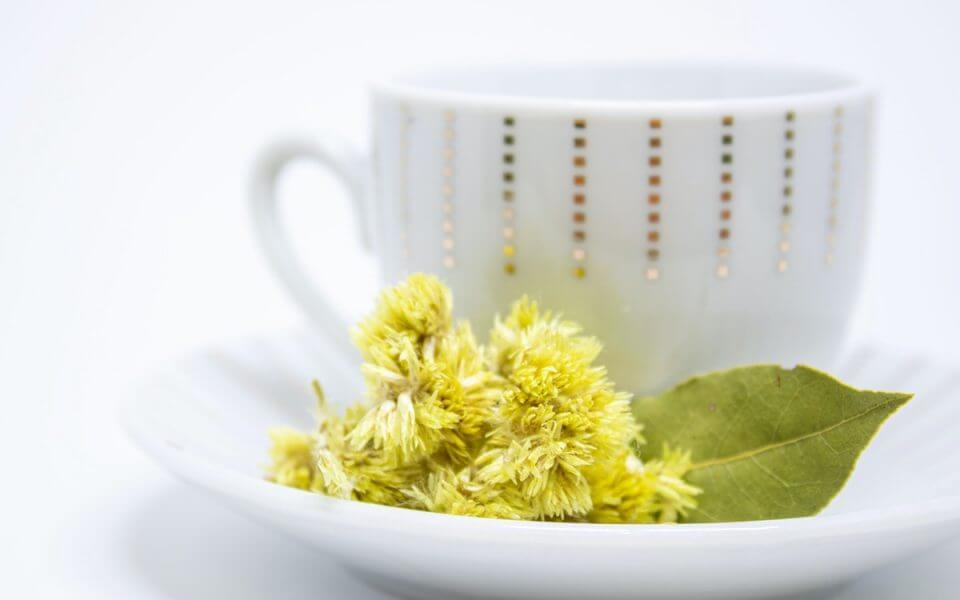 A picture of a teacup and flowers