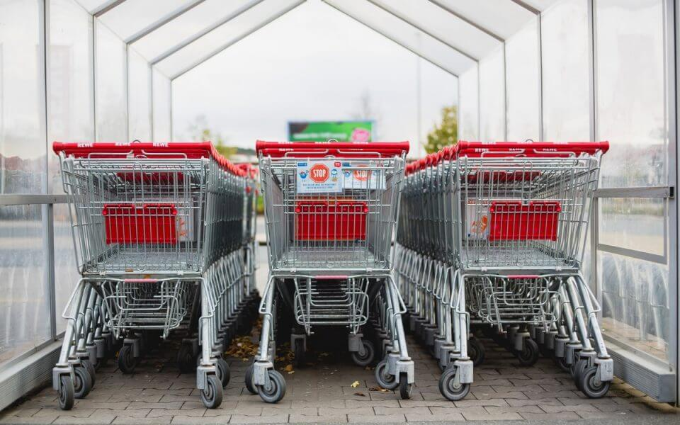 A photograph of trolleys at a supermarket